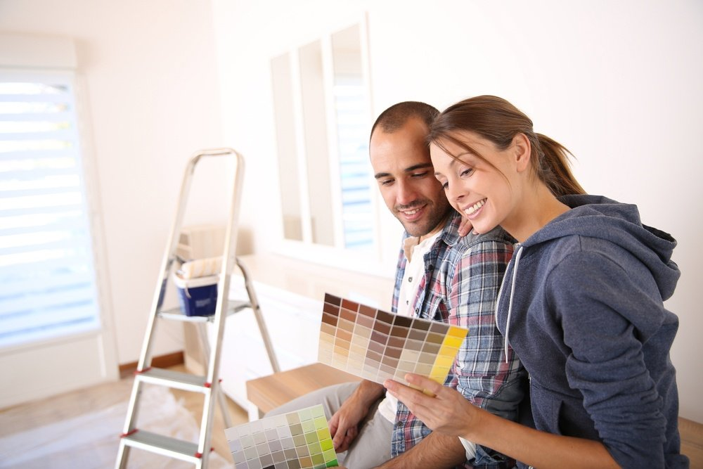 Couple in new house choosing color for walls.jpeg
