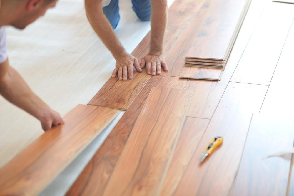Installing laminate flooring in new home indoor.jpeg
