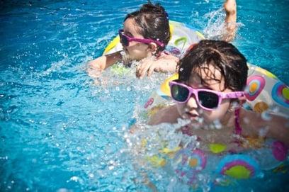 Toddler girls in a pool